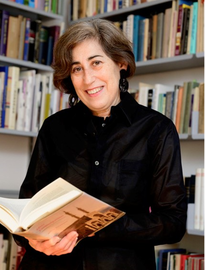 Professor Frishman, surrounded by books